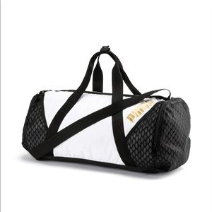 PUMA AMBITION GOLD BARREL BAG